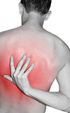 Back injury. Man pointing to back injury Stock Images