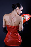 Back latino woman with red fan Royalty Free Stock Images