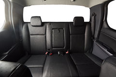Back leather seat of modern pickup. Car interior with isolated windows stock photos