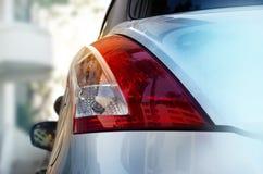 Back light of city car on the street background Stock Photo