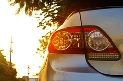 Back light of city car on the street background, vibrant concept Stock Image