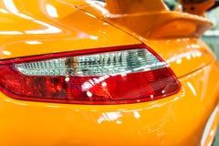 Back light of a modern sport car. Back light of an orange modern sport car royalty free stock image