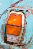 Back light of the old car. Back light of the old abandoned car Stock Photos