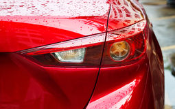 Back light of sport car after the rain on the street background Royalty Free Stock Image
