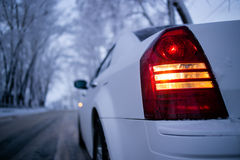 Back light of white car upside-down view. Winter Stock Photography