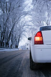 Back light of white car upside-down view. Winter Royalty Free Stock Image