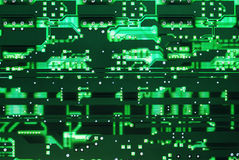 Back lighted green circuit board. May be for background Royalty Free Stock Photo