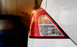 Back lights of white car after the rain on car parking Stock Photo