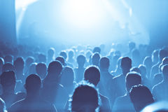 Blue ambiance and Crowd in silhouette during a Concert. Back lit Blue ambiance and and Crowd in silhouette during a Concert Royalty Free Stock Images
