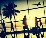 Back Lit Business People Traveling Airplane Airport Concept Stock Photos