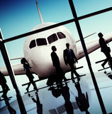 Back Lit Business People Traveling Airplane Airport Concept.  Royalty Free Stock Photos