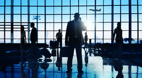 Back Lit Business People Traveling Airport Passenger Concept Stock Photography