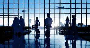 Back Lit Business People Traveling Airport Passenger Concept Royalty Free Stock Photos