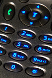 Back Lit Cell Phone Keypad with Numbers. Open flip cell phone with back lit key pad with glowing blue numbers keys ready to dial a telephone call Stock Photo