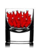 Back lit glass with little red bottles inside Royalty Free Stock Photos