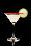 Back lit key lime martini with red sugar Stock Photography