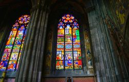Back-lit pictorial stained glass windows. From inside church in Vienna Stock Photo