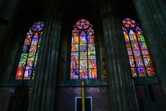 Back-lit pictorial stained glass windows. Three panes back-lit pictorial stained glass windows from inside church in Vienna Royalty Free Stock Image