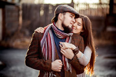 Back lit romantic couple in a stylish brown clothes Stock Photography