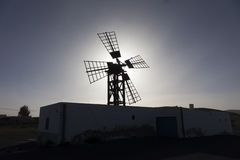 Back lit silhouette of windmill in Lajares Fuerteventura Las Palm Royalty Free Stock Images