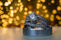 Back Lit Silver Engagement And Wedding Rings Royalty Free Stock Photos
