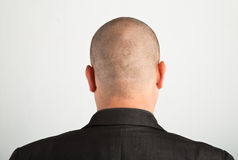 Back of male head. On gray background stock image