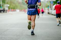 Back male runner. Running in city marathon race Royalty Free Stock Photography