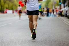Back male runner. Running streets of the city on background of runners Royalty Free Stock Photos