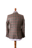 Back of Male suit on the dummy. Isolated on the white Royalty Free Stock Photography