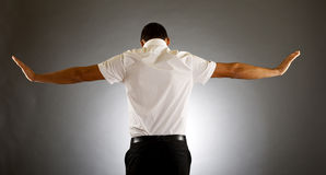 Back of a man. Back picture of man with hands spread tot sides Royalty Free Stock Photo