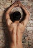 Back of man. Sexy male near brick wall Stock Photo