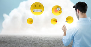 Back of man with emojis and flare against cloud. Digital composite of Back of man with emojis and flare against cloud Stock Photography