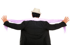 The back of man with open hands. Wearing a hat and scarf Royalty Free Stock Images