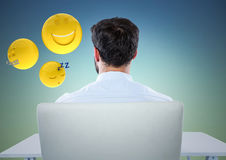 Back of man sitting with emojis against blue green background. Digital composite of Back of man sitting with emojis against blue green background Royalty Free Stock Photo