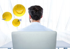 Back of man sitting with emojis against white window. Digital composite of Back of man sitting with emojis against white window Stock Images