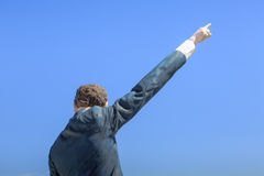 Back of a man statue with an arm stretched out in the air Stock Image