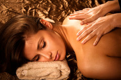 Back massage. Woman getting back  massage in spa salon Royalty Free Stock Photo