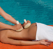 Back massage. By lavanda hot bags near to swiming pool Royalty Free Stock Image