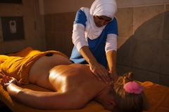 Back massage in Asian beauty spa Stock Photos