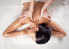 Back Massage. Asian woman enjoying a back massage at a spa centre royalty free stock image