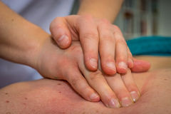 Back massage, closeup to hands.  royalty free stock photos
