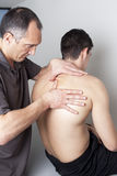 Back massage on man Stock Image