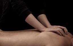 Back massage. Man getting a back massage royalty free stock photography