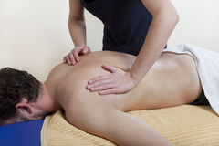 Back massage on a massage table Stock Photography