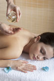 Back Massage with Oil. Beautiful relaxed woman receiving back massage with oil Stock Photo