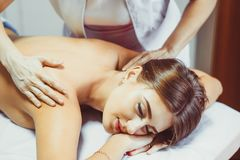 A back massage in the salon royalty free stock images