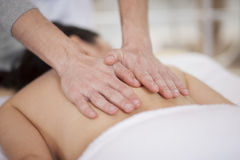 Back massage at a spa Royalty Free Stock Photo