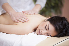 Back massage at a spa Stock Photo