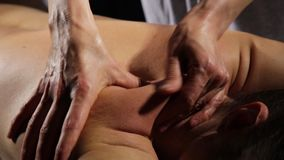 Close-up back massage in spa salon. massage therapist does a classic massage on a female body stock footage