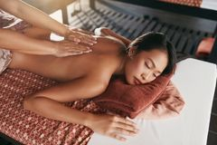 Back Massage At Thai Spa. Woman Having Body Massage At Salon. Masseur Massaging Female. High Resolution royalty free stock images